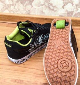 Кроссовки на колёсиках Heelys 39 размер. Новые.