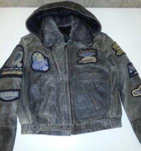 Новая кожаная куртка 10-12 лет