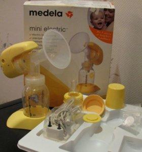 Молокоотсос Medela electric mini