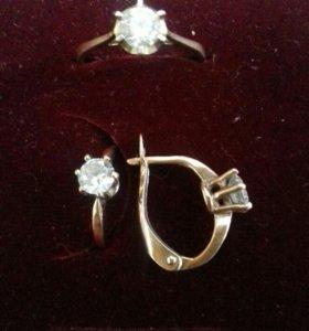 Комплект кольцо и серьги.