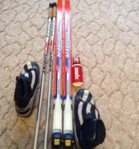 Беговые лыжи с креплениями,ботинки, палки