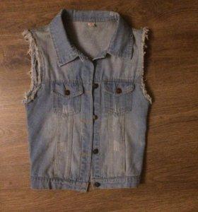 Продам жилетку джинсовую