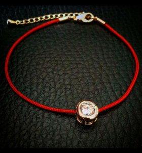 Красная нить с кристаллом