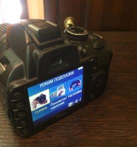 Nikon D3100 + nikkor 18-55 mm VR