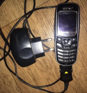 Телефон на запчасти + зарядник