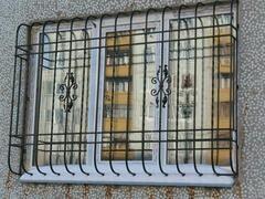Решетки на окна.из прутка и элементами ковки