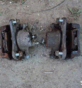Суппорта тормозные передние для Toyota Corolla 120