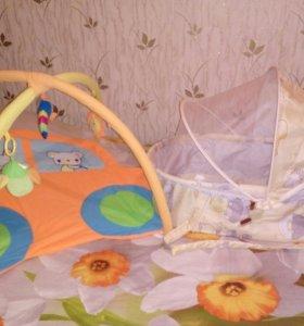 Продам люльку в кроватку и детский коврик.