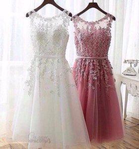 Много вечерних платьев новых