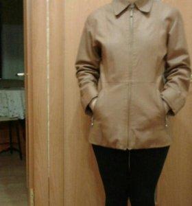 Куртки коженные