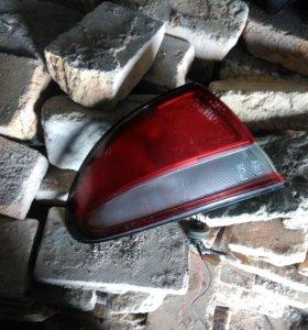 Задний левый фонарь Mazda Xedos 6