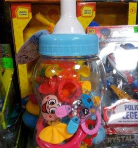 Бутылочка с погремушками. На рождение ребенка.