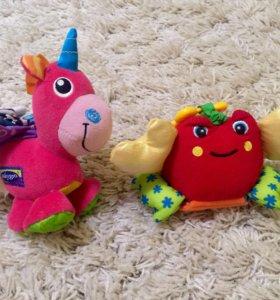 Фирменные игрушки и погремушки