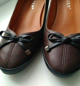 Новые неношенные туфли