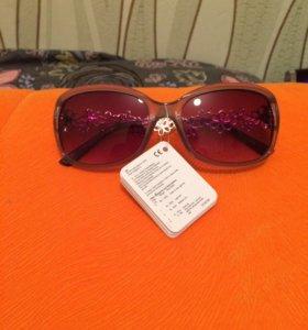 Солнцезащитные очки .