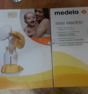 Электро молокоотсос Medela