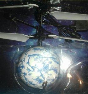 Летающий светящейся шарик