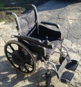 Электрическую инвалидную коляску навую