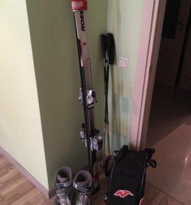 Комплект: горные лыжи, ботинки, палки, сумка