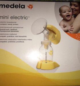 Электрический молокоотсос Medela