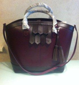 Новая кожаная сумка цвета бордо
