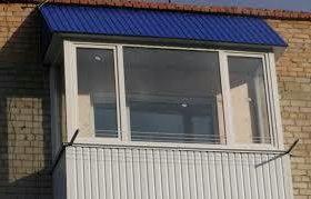 Обшивание балконов металлопрофелем.