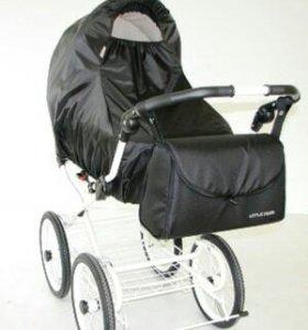 Дождевик на коляску новый