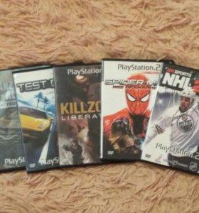 Стопка дисков на PlayStation 2 ( 5 штук)