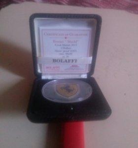 серебреная монетка