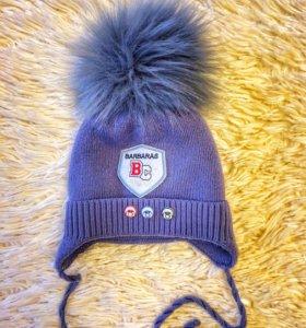 Качественная,тёплая и стильная шапочка.С 0-6мес.