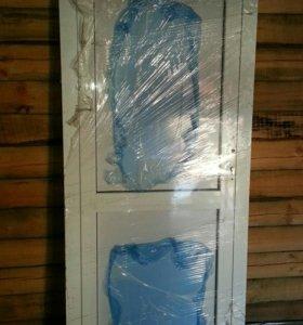 Продам входную дверь из алюминиевого профиля ПВХ