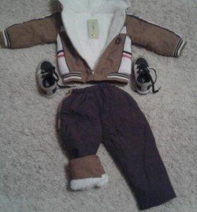 Продам костюмчик новый.