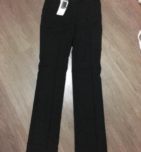 Новые брюки Оджи с биркой