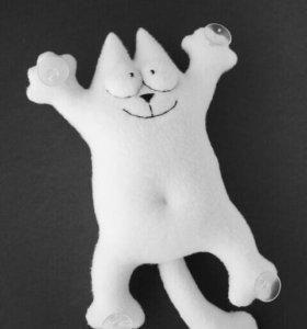 Кот Саймона на присосках