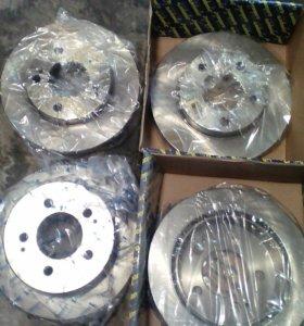 Тормозные диски на саненг кайрон новые