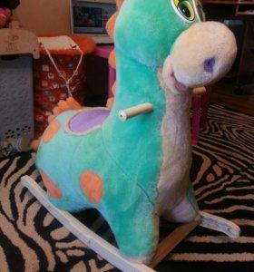 Детская качалка-динозаврик.
