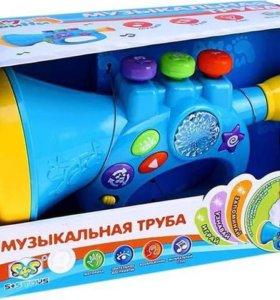 Музыкальная труба игрушка