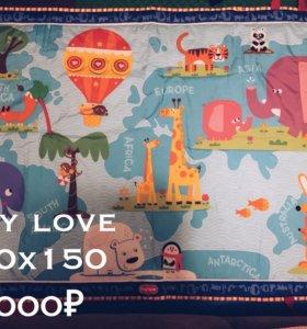 Развивающий коврик и игрушки для малыша
