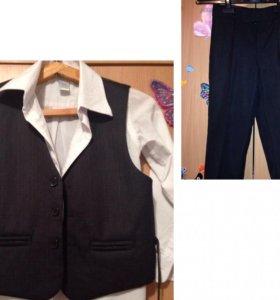 Брюки, жилетка и рубашка