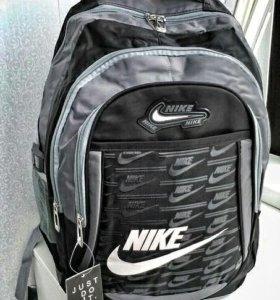 Рюкзаки NIKE серо-черные.