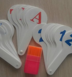 Буквы, цифры, счётные палочки.
