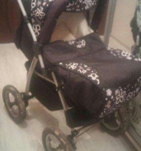 Продается коляска б/у черного цвета два в одном