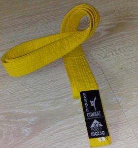 Желтый пояс по каратэ или другим боевым искусствам