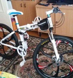 Горный велосипед на литых дисках.