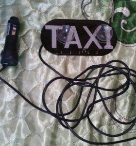 Надпись такси светящаяся