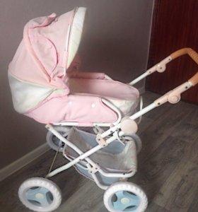 Детская игрушечная коляска (трансформер )