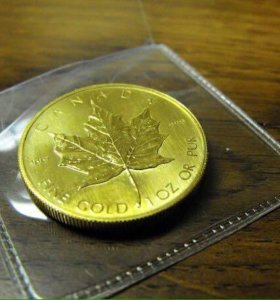 Золотая монета 999