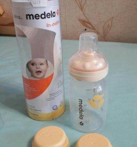 Бутылочку Medela со смартсоской.