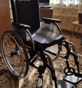Прогулочная инвалидная коляска.