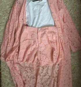 Новый костюм розового цвета с шортами 44 размера